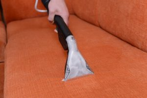 An extraction machine in action during upholstery cleaning in Sydney