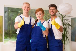 three cleaners giving the thumbs up